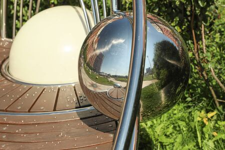 Reflections of the city in a metal ball. Modern Architecture Foto de archivo
