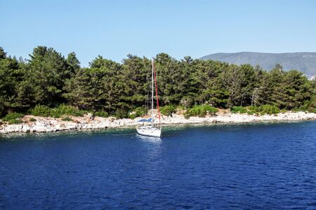 Lonely yacht on the picturesque coast of Kefalonia. Greece