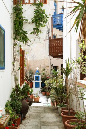 Small chapel in an alley of a Greek city. Greece, Nisyros island