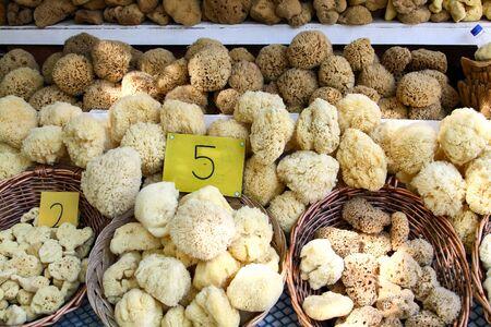 Greek souvenir - sea sponge in the bazaar of Symi island. Greece