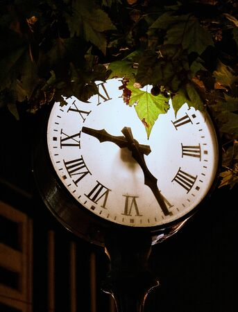 Lighted clock on the night street of Athens. Greece