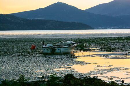 Fishing boat with a motor on Lake Orestiada in Kastoria. Greece