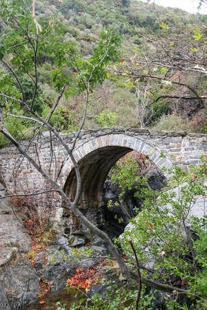 Stone bridge over a mountain river on Athos. Greece, Halkidiki