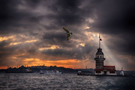 Maiden's Tower and Istanbul Landscape on a cloudy day with changing lights. Maiden's Tower or Kiz Kulesi located in the middle of Bosphorus, Istanbul in Turkey.