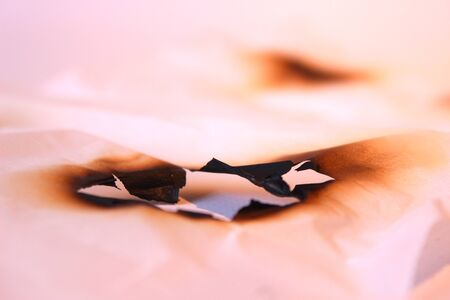 folio paper white paper burned hole scorched sea particle