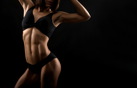 Beautiful fitness woman at the studio Stock Photo