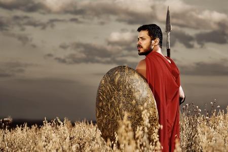 over the shoulder: Warrior wearing like spartan looking over shoulder. Stock Photo