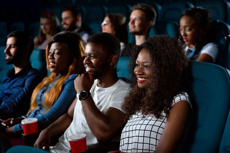 Group of multicultural friends at the movie theatre