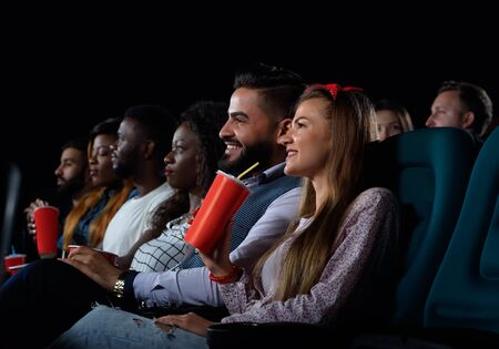 Group of friends watching movies at the local cinema Stock fotó