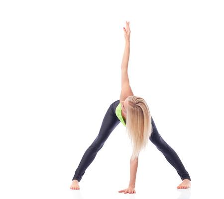 Attractive female gymnast exercising at studio Stock Photo