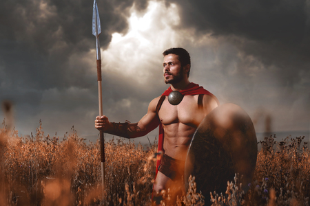 Warrior wearing like spartan going in attack. Stock Photo