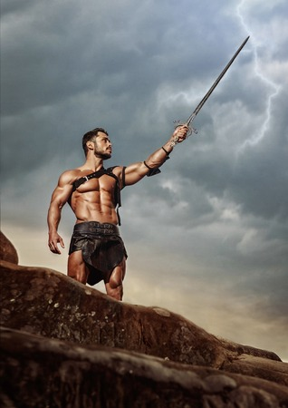 Young warrior on a mountain peak Standard-Bild