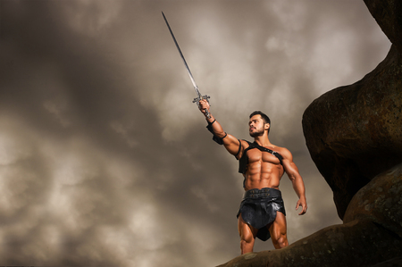 Young warrior on a mountain peak Stockfoto