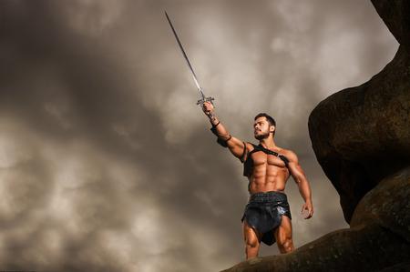 Young warrior on a mountain peak Foto de archivo