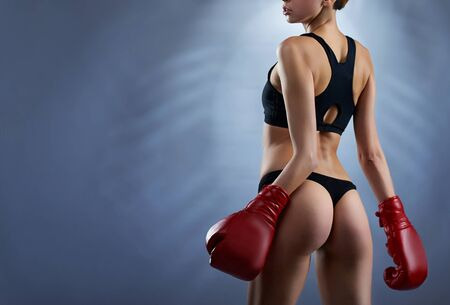 Sexy female boxer wearing sport top Stock Photo
