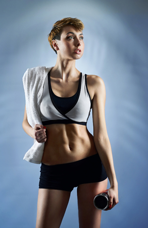 Beautiful fit woman wearing gym clothing