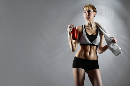 Feeling fit. Female fitness trainer wearing sports clothing posing