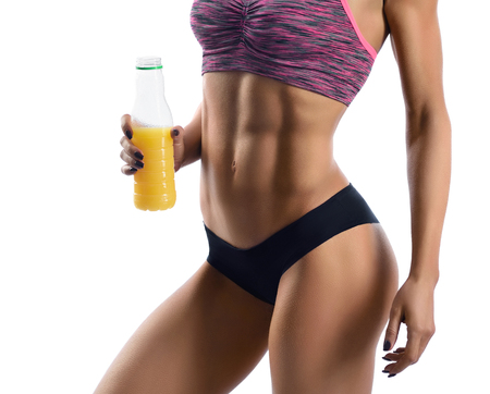Fitness woman with a bottle of juice Imagens