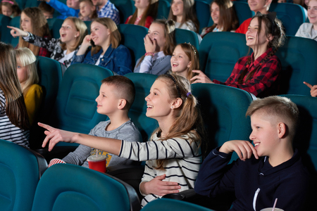 Children watching movies at the cinema 版權商用圖片