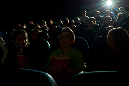 Children watching movies at the cinema Stock Photo