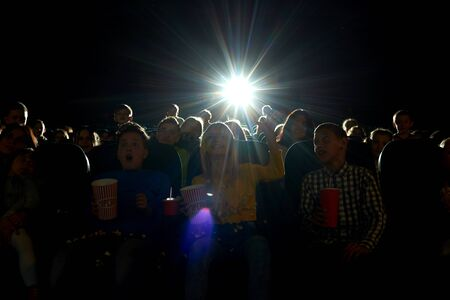 Cinema auditorium full of kids during movie premiere Stock Photo
