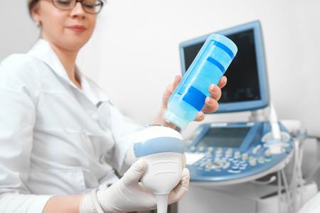 Young woman getting breast ultrasound scanning Standard-Bild