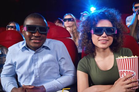 blockbuster: Young people watching 3D film at the movie theatre
