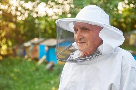 Senior beekeeper working at his apiary