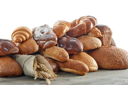 bakery products: Assorted breads isolated on white Stock Photo