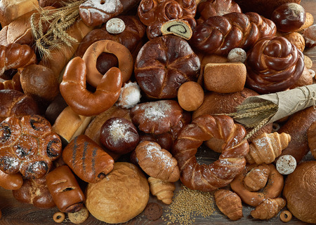 Assorted breads isolated on white Фото со стока