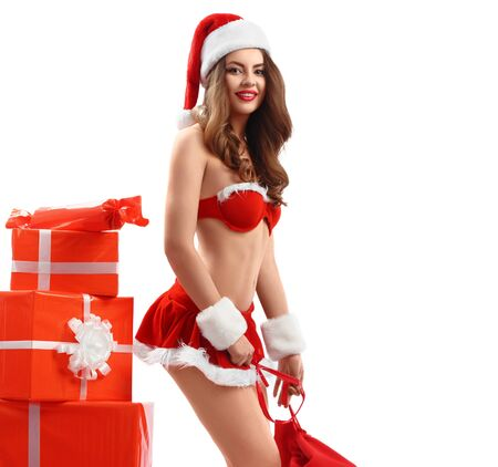 beautiful sexy young woman in red suit of Santa Claus with gifts