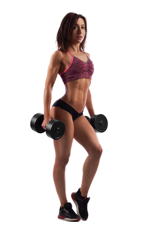 Attractive fitness woman with dumbbells