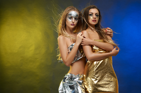 Two slim girls with an artistic make-ups. Stock Photo