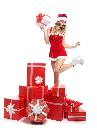 Seductive woman in a Christmas outfit at studio