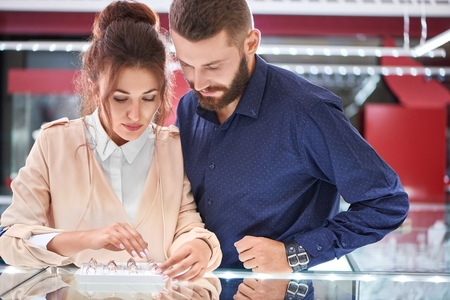 Couple shopping at jewelry store Stock Photo