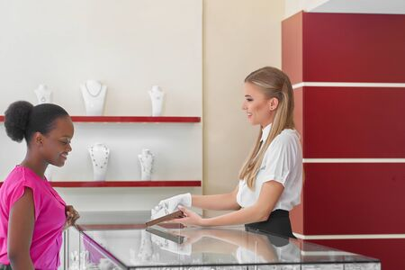 Woman buying jewelry at the store Stock Photo