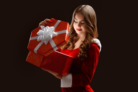 Curly Girl In The Red Suit Opens A Gift For New Year 2018,2019 ...