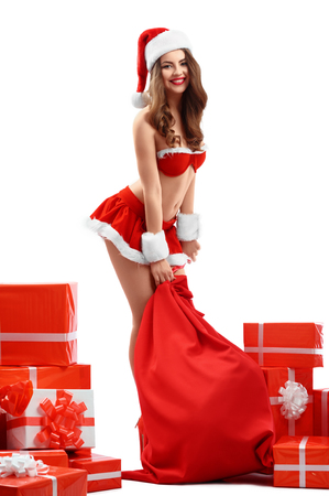 Beautiful, sexy young woman in red costume Snow Maiden, smiling, Stock Photo