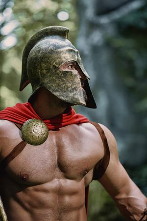 Spartan warrior in the woods Foto de archivo