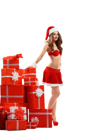 beautiful woman in red suit of Santa Claus with gifts for New Year 2018,2019