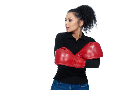 Pretty girl wearing boxing gloves