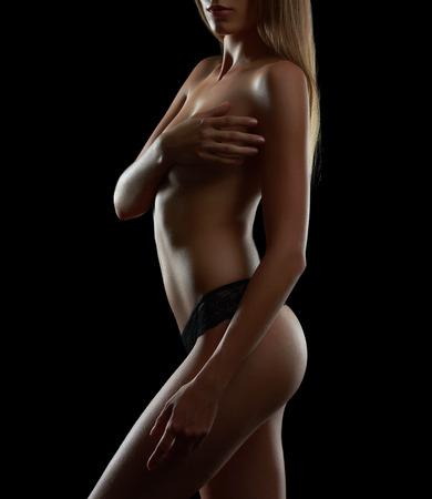 Slim woman posing in black lingerie panties