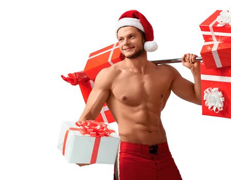 Ripped Santa Claus holding barbell and giving presents