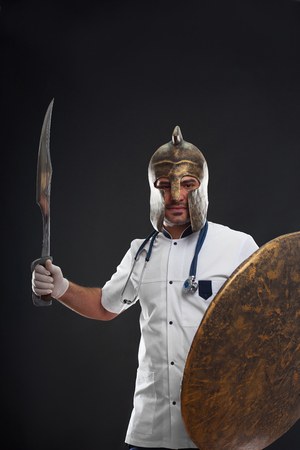 Male doctor wearing medieval armor