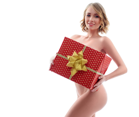 Gorgeous naked woman posing with a gift box