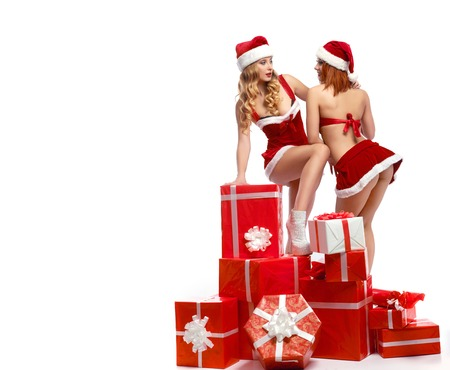 Beautiful girls wearing Christmas outfits with presents Stock Photo