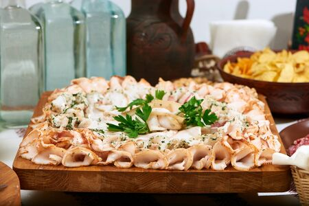 Wooden board served with sliced lard Stock Photo
