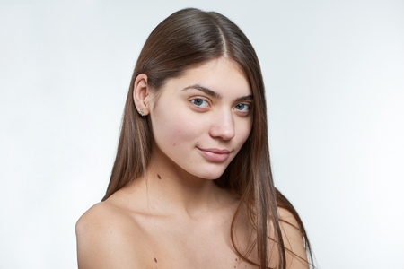 Fullface type half profile portrait of a young beautiful model without makeup on her face. Stock Photo