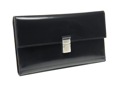 Black leather glancy wallet for woman. It has many sections for paper money, coins, credit cards. Comfortable for carrying in bag. Photo was made on the white studio background.