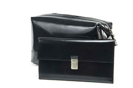 Glancy, black colored women s wallet and cosmetic bag with a metallic zipper. Comfortable for saving cosmetic, money and credit cards and carrying in bag. Close-up was made on the white studio background. Stock fotó